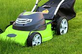 picture of grass-cutter  - clean cutting the grass with lawn mower - JPG