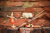 pic of sag  - Thai dancing doll for blessing in the Buddhist temple with the ancient brick wall - JPG