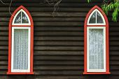 image of lace-curtain  - Dark wall of weatherboard church with 2 pointed - JPG