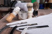 image of barber razor  - hairdressing equipment like razor and  brush and mousse and  towel  in  professional  hairdressing salon - JPG