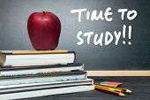 picture of time study  - Apple on books and time to study handwritten on the chalkboard in the background - JPG
