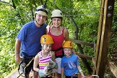 stock photo of canopy  - Family enjoying a Zipline Adventure on Vacation - JPG