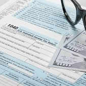 stock photo of cpa  - United States of America Tax Form 1040 with glasses