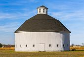 pic of lightning-rod  - An old white round barn stands on a farm in America - JPG