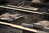 picture of concrete pouring  - Construction site detail with iron rack for concrete pouring on a new building foundation - JPG