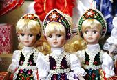 stock photo of dress-making  - Traditional handmade toys puppets dolls in symbolic artistic dress