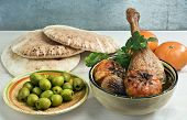 picture of tagine  - Moroccan duck leg tagine with tangerines onions and fresh cilantro served with pita bread and green olives - JPG