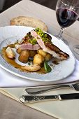 stock photo of veal  - Piece of veal potatoes and shallots on a plate