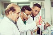 image of conduction  - Group of scientists conducting research in a lab environment - JPG