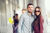 foto of gullible  - Happy girl and boy teenagers standing outside - JPG