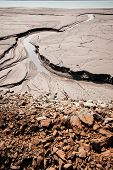 stock photo of iron ore  - dried sludge in the settling tank to defend the technical water after iron ore beneficiation - JPG