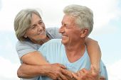 image of retirement age  - Elderly couple relaxing on a sunny day together - JPG
