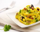 foto of pasta  - Paglia e fieno or Straw and hay tagliatelle Italian pasta with a mixture of yellow and green spinach - JPG