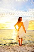 image of hawaiian girl  - Surfing surfer girl looking at ocean beach sunset - JPG