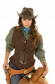 stock photo of pistols  - a cowgirl holding on to her saddle with her hand on her pistol ready to go - JPG