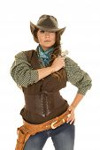 pic of pistols  - a cowgirl with a serious expression on her face holding on to her pistol on her shoulder - JPG