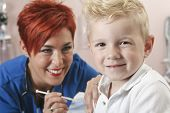 picture of flu shot  - A Small boy with as nurse gives him a shot - JPG