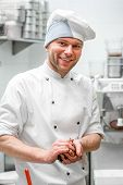 picture of confectioners  - Portrait of handsome confectioner at the restaurant bakery kitchen - JPG
