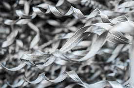 foto of scrap-iron  - Metallic Swarf and Lathe Metal Fragments with metal springs.close-up ** Note: Soft Focus at 100%, best at smaller sizes - JPG