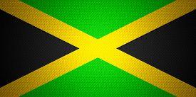 stock photo of jamaican flag  - Jamaica flag or Jamaican banner on abstract texture - JPG