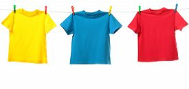 picture of clotheslines  - Three colorful shirts hanging on the clothesline - JPG