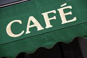 foto of canopy  - Cafe sign in Paris printed on a green entrance canopy - JPG