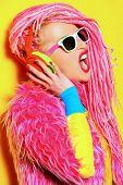 picture of dreadlock  - Glamorous modern DJ girl wearing bright clothes - JPG