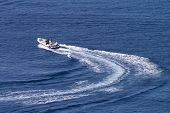 picture of veer  - motorboat changing course at full power leaving curved wake behind