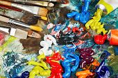 stock photo of paint brush  - Palette with oil paint and brushes - JPG