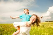 stock photo of mother child  - Mother and Son Having Fun - JPG