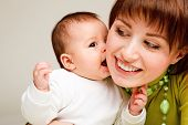picture of happy baby boy  - Closeup portrait of a sweet baby kissing  mother - JPG