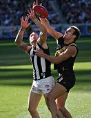 MELBOURNE - AUGUST 15: Collingwood's Dane Swan (L) is grabbed in a strong marking contest in their w