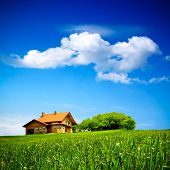 stock photo of barn house  - House on green field - JPG
