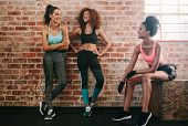 Female Friends Taking Rest After Fitness Workout poster