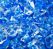 close-up of ice cubes on blue