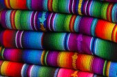stock photo of green-blue  - Colorful blankets at a mayan market in the highlands - JPG