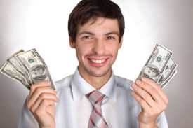 image of holding money  - man holding money - JPG