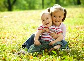 pic of children playing  - Cute children are playing in autumn park - JPG