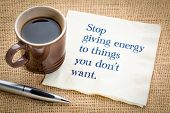Stop giving energy to thing you do not want - handwriting on a napkin with a cup of coffee poster