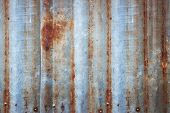 Background Of Peeling Paint And Rusty Old Metal. Zinc Wall Texture Pattern Background Rusty Corrugat poster
