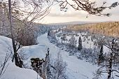 Frozen River On The Background Of Snowy Mountains And Taiga. Wild Nature. Far East, Sakhalin Island, poster