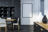 Interior Of Dining Room With White Walls, Wooden Floor, Long Table With Chairs And Black Cupboard. 3 poster