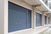 Shutter Door Or Roller Door And Concrete Floor Of Commercial Building poster
