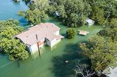 Aerial Drone View Of Historic Flooding Home Under Water Or House Under Flood Water , Lake Travis , O poster