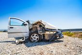 Close-up Of Crashed Car After Accident, Behind Crashed Barrier On Road, Sunny Day poster