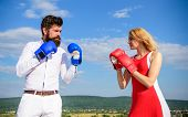 Relations As Struggle Concept. Man And Woman Fight Boxing Gloves Blue Sky Background. Couple In Love poster
