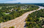 Aerial Drone View With Austin , Texas In The Background Skyline With Flooded Chocolate Milkshake Col poster