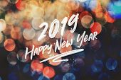 Brush Stroke Handwriting 2019 Happy New Year On Abstract Festive Colorful Bokeh Light Background,hol poster