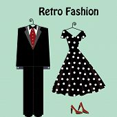 stock photo of poka dot  - retro fashion male and female on hangers - JPG