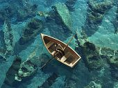 stock photo of sailing vessels  - boat sails through the graveyard of sunken boats - JPG